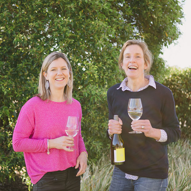 Bec and Jules Ashmead with a bottle of Small Victories Vermentino